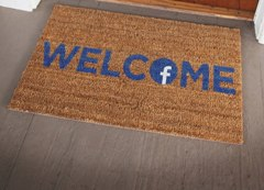 Facebook logo on the letter o of a welcome mat