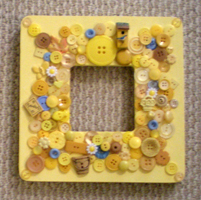 button artwork-button mirror-yellow
